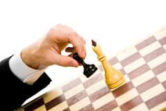 a chess player making his next chess move - stock photo