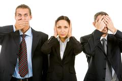 Row of business partners closing their eyes, mouth and ears Stock Photos