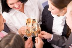 Stock Photo of photo of happy colleagues holding champagne flutes at corporate party