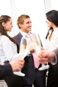 Stock Photo of image of cheering friends interacting at corporate party