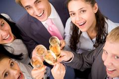 Stock Photo of photo of happy friends cheering up during corporate party