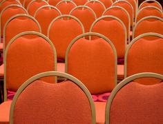 Stock Photo of image of several rows of red armchairs in conference hall
