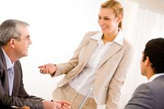 image of businesswoman sharing her ideas at meeting - stock photo