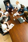 above view of friendly team discussing working plan - stock photo