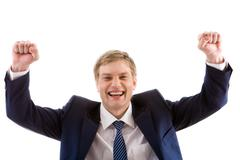 Portrait of lucky winner showing his happiness by keeping arms raised Stock Photos