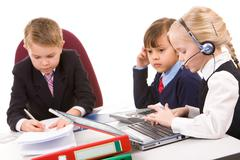 Photo of smart girl talking by the phone with serious boss and child near by Stock Photos