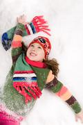 above view of cheerful girl having fun in snow - stock photo
