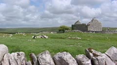Stone house or church Ruin at Caherconnell, The Burren, Ireland Stock Footage