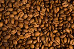 Background of black roasted coffee beans Stock Photos
