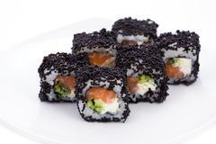 image of maki sushi rolls in black caviar - stock photo