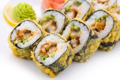 close-up of maki sushi on special plate - stock photo