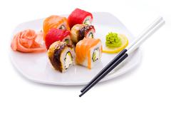 image of maki sushi rolls served with wasabi and pickled ginger - stock photo