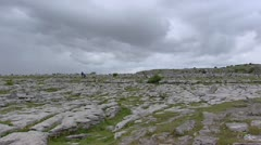 Burren landscape pan megalithic tomb Poulnabrone Dolmen Stock Footage