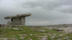 Ireland - Burren landscape pan Poulnabrone Dolmen - side view Stock Footage
