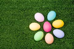 Close-up of colorful easter eggs on green grass Stock Photos