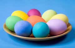 close-up of coloured traditional eggs lying on the plate - stock photo