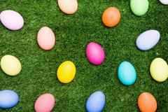 Backdrop of fresh grassland with colorful eggs on it Stock Photos