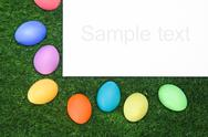 Stock Illustration of easter card with multicolored eggs on green grass and blank space for your greet