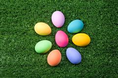 Photo of easter eggs forming flower shape on green grass Stock Photos