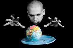 conceptual image of earth model on saucer with magician keeping his hands over i - stock photo