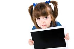 Portrait of intelligent schoolgirl showing something on laptop screen and lookin Stock Photos