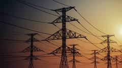 Electricity pylons and power lines industry metal construction wires sun and sky - stock footage