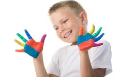 Image of preschooler with painted hands over white background Stock Photos