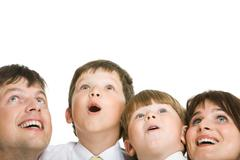 Photo of surprised family members looking upwards with excitement Stock Photos