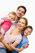 portrait of happy couple with their son and small daughter over white background - stock photo
