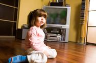 Stock Photo of image of little girl sitting on the floor at home