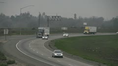 Trucks and Traffic on Highway Curve Approaching on Foggy Day Stock Footage
