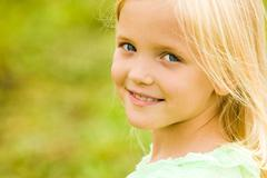 head of girlie looking at camera with smile - stock photo