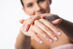 Image of female manicured hands on background of woman Stock Photos