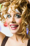 photo of happy girl with wavy hair looking at camera and laughing - stock photo