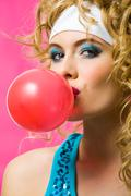 portrait of gorgeous female with chewing gum looking at camera - stock photo