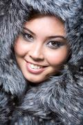 face of pretty woman wearing luxurious furs - stock photo