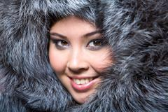 Face of pretty woman wearing luxurious furs Stock Photos