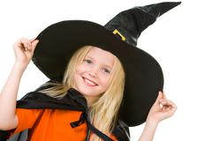 portrait of girl in witch costume posing before camera - stock photo