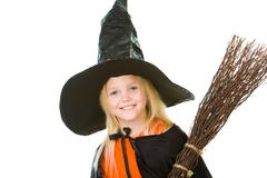 Photo of girl in halloween costume and broom smilling at camera Stock Photos