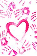 picture of pink heart surrounded by palm prints over white background - stock photo