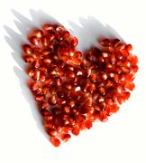creative photo of red heart made up of pomegranate seeds - stock photo