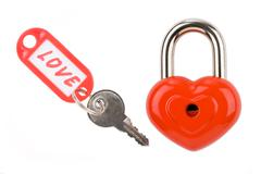 photo of padlock and key with love label on a white background - stock photo