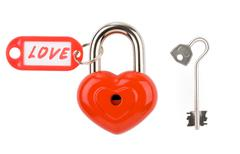 Stock Photo of red lock and key isolated on a white background