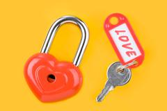 Image of red lock and key with love label Stock Photos