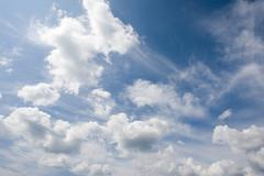 Photo of bright blue sky with white clouds Stock Photos