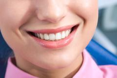 close-up of happy female smile and healthy teeth - stock photo