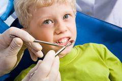 photo of little boy before mouth checkup in dental clinic - stock photo