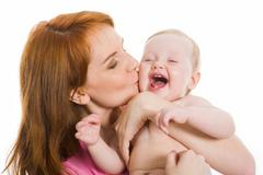 image of pretty woman with her little baby on white background - stock photo