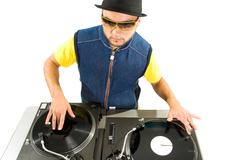 Stock Photo of portrait of smart deejay spinning turntables