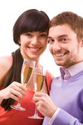 portrait of happy couple with champagne flutes celebrating holiday - stock photo